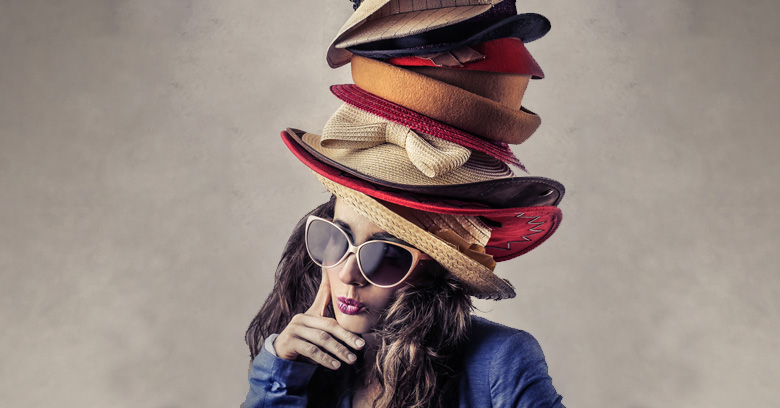A women wearing different hats.