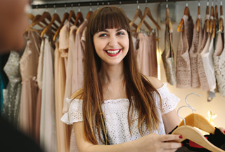A part-time store associate smiling at her customer in a store.